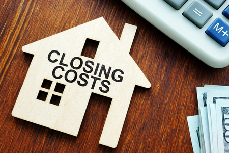 Photo for Closing costs. Model of house and money. - Royalty Free Image