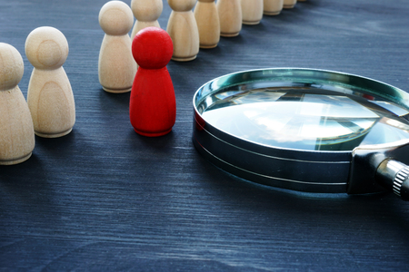 Photo pour Identify concept. Recruitment and talent management. Red figurine and magnifier. - image libre de droit