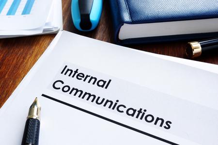 Foto de Stack of internal communications documents on a table. - Imagen libre de derechos