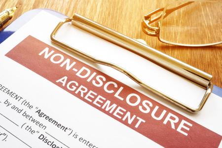 Photo pour Confidentiality and non-disclosure agreement form on a desk. - image libre de droit