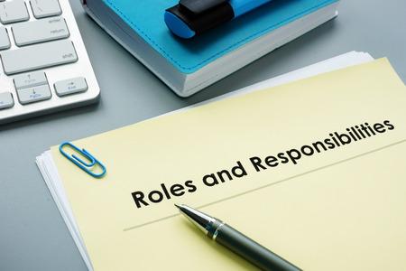 Photo pour Roles And Responsibilities documents in the office. - image libre de droit