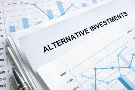 Foto de Documents about Alternative investments with financial charts. - Imagen libre de derechos
