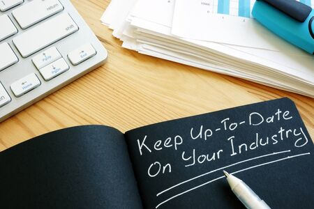 Photo pour Keep Up To Date on Your Industry sign. Lifelong learning. - image libre de droit