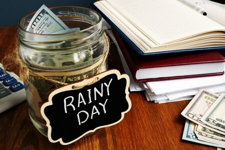 Photo for Rainy Day Fund label on the jar with money. - Royalty Free Image