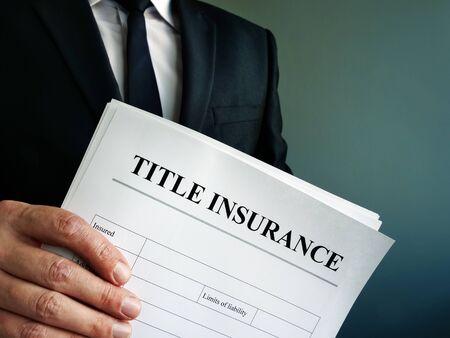 Photo pour Title Insurance agreement in the hands of a businessman. - image libre de droit