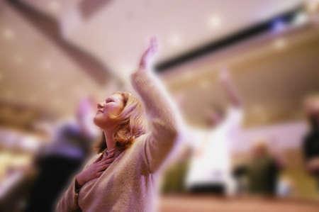 Woman worshipping in church