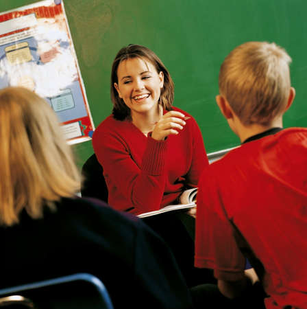A teacher with students in a classroom