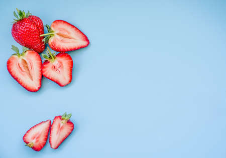 Foto de fresh juicy strawberries on blue background - Imagen libre de derechos