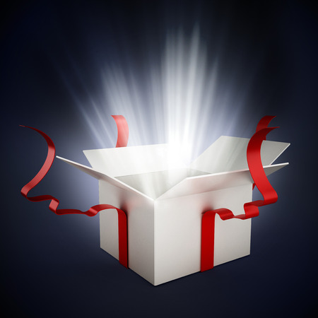 Photo pour Open giftbox with a white glow on dark background - image libre de droit