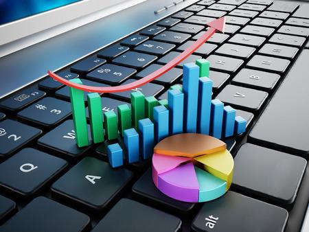 Foto de Financial charts standing on laptop computer keyboard - Imagen libre de derechos