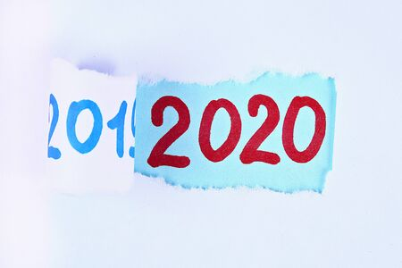 Photo for Torn piece paper revealing word new year 2020. Christmas. Business, finance, salary, crisis, and development concept. New year planing. 2020 goals. - Royalty Free Image