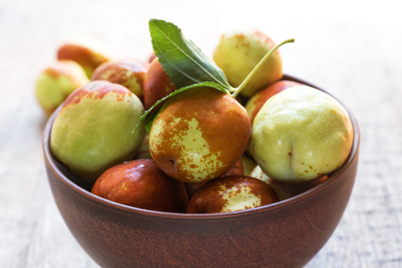 Photo for Fresh jujube on wooden table. Unabi fruit. - Royalty Free Image