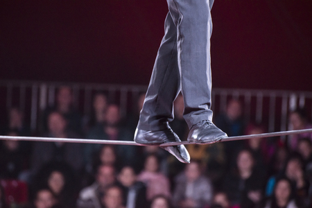 Photo pour A man walks in a rope in a circus.  - image libre de droit