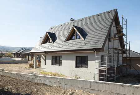 Photo pour New build houses. Black roof, mountain - image libre de droit