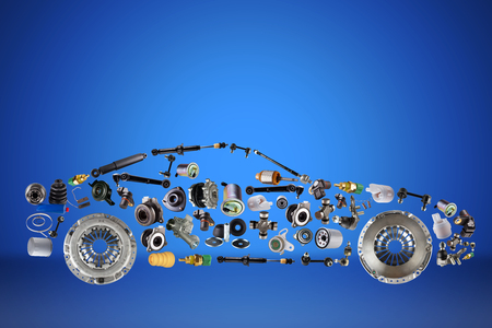 Foto de Passenger car assembled from new spare auto parts for shop aftermarket. Isolated on blue background. - Imagen libre de derechos