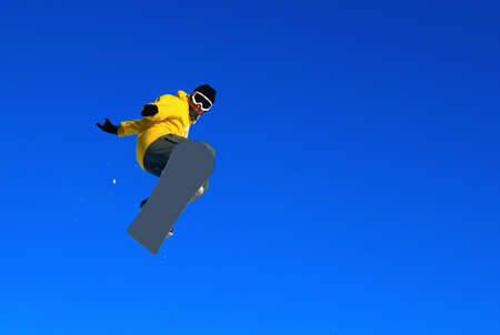 Jump from the big springboard, flight against the blue sky