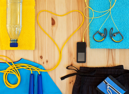 Sportswear and player with headphones. Clothing and sports accessories for fitness