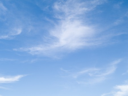 Stock photo of a blue sky with white whispy clouds.