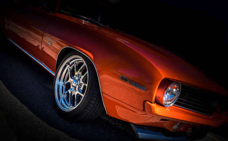 Photo for orange vintage american classic car on black background and chrome wheels - Royalty Free Image