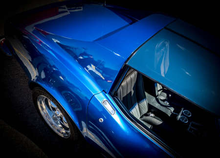 Photo for BLUE AMERICAN CLASSIC SPORTS CAR ON BLACK BACKGROUND - Royalty Free Image
