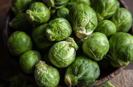 Photo pour fresh Brussels Sprouts in wooden bowl on rustic background - image libre de droit