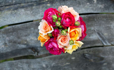 roses on wooden table, top view