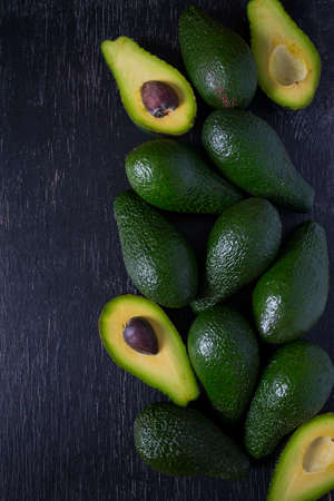 Photo for avocado on dark wooden surface - Royalty Free Image