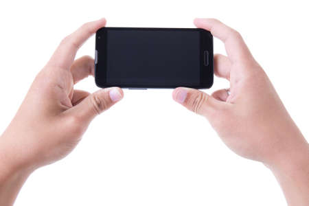 Photo for hands holding mobile smart phone with blank screen isolated on white background - Royalty Free Image