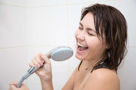 Photo for portrait of happy funny woman singing in shower - Royalty Free Image