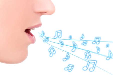 Foto de music concept - female mouth singing over white background - Imagen libre de derechos