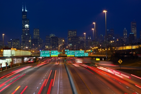 Chicago urban skyscrapers with traffic at dusk, IL, USA