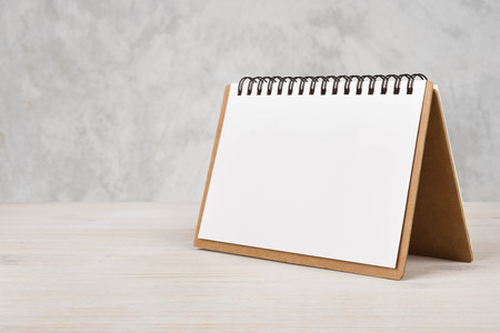 Photo for Blank paper calendar on wooden table - Royalty Free Image