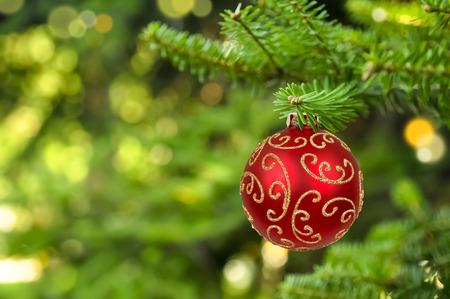 Foto de Christmas ball hanging on abstract lights background - Imagen libre de derechos