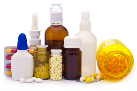 Foto de Composition of medicine bottles and pills isolated on white - Imagen libre de derechos