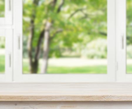 Foto de Wooden table over summer window background - Imagen libre de derechos