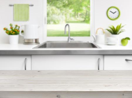 Wooden table on kitchen sink window background