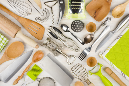 Foto de Background of kitchen utensils on wooden kitchen table - Imagen libre de derechos