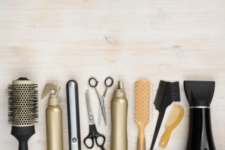 Foto de Hairdressing tools on wooden background with copy space at top - Imagen libre de derechos