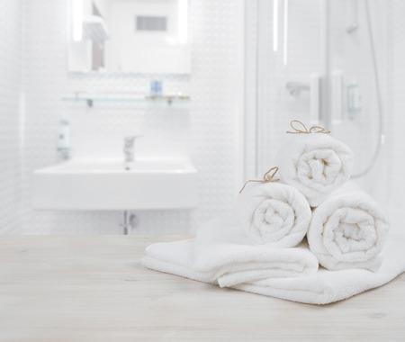 Foto de White folded spa towels on defocused interior background of bathroom - Imagen libre de derechos