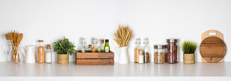 Photo pour Kitchen shelf with various herbs, spices, utensils on white background - image libre de droit