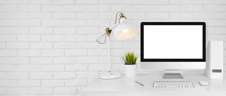 Photo pour Design studio concept with workplace and white brick wall background - image libre de droit