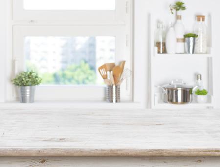 Foto de Empty table on blurred background of kitchen window and shelves - Imagen libre de derechos