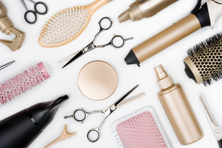 Photo pour Hairdressing tools and various hairbrushes on white background top view - image libre de droit