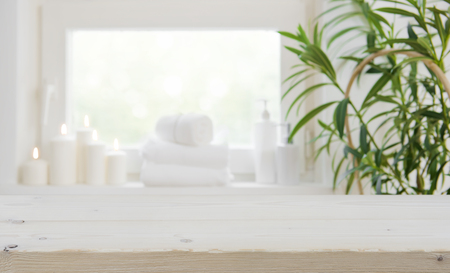 Foto de Wooden tabletop with copy space over blurred spa window background - Imagen libre de derechos