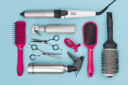 Photo pour Professional hairdressing tools isolated on blue background, view from above - image libre de droit