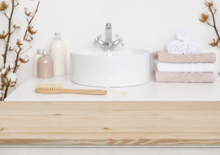 Foto de Wooden table top and blur bathroom interior - Imagen libre de derechos
