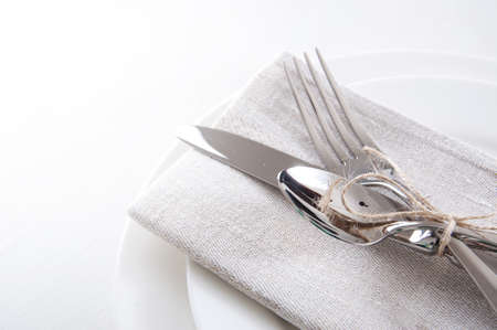 Photo for Table setting in white and gray colors with linen napkins and silverware - Royalty Free Image