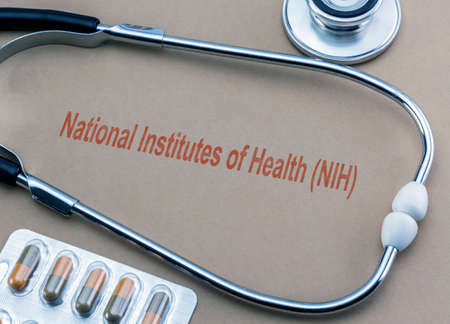 Photo pour Stethoscope and capsules, digital composition with the text National Institutes of Health (NIH), conceptual image - image libre de droit