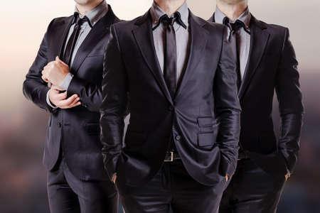 Foto de Close up image of three business men in black suit - Imagen libre de derechos