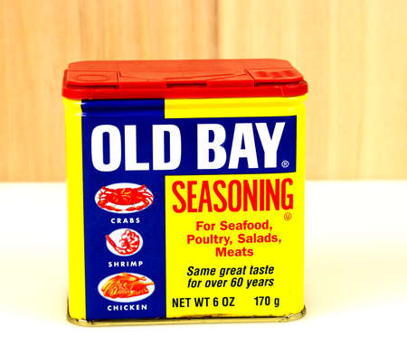 RIVER FALLS,WISCONSIN-NOVEMBER 08,2016: A vintage Old Bay seasoning can with a wood background.